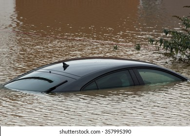 YORK, UK - DECEMBER 28th 2015: Flooded streets of York City Centre and a submerged car after heavy rain, on 28th December  2015,