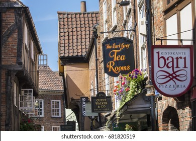 YORK, UK - JULY 18TH 2017: A view of the variety of shops and restaurants on The Shambles in the historic city of York, UK, on 18th July 2017.