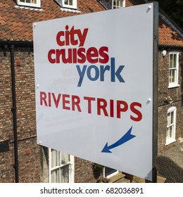 YORK, UK - JULY 18TH 2017: A sign advertising the City Cruises river trips in the historic city of York in England, on 18th July 2017.