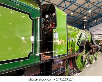 York / UK - July 28 2019: Green steam train engine