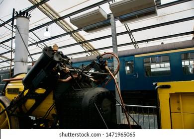 York / UK - July 28 2019: Rocket model and old train in National Railway Museum, York, UK