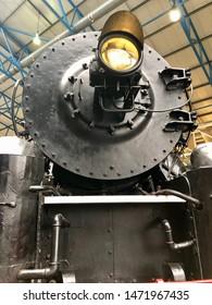 York / UK - July 28 2019: Detail of steam engine locomotive in National Railway Museum, York, UK