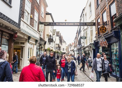YORK, UK - JUN06, 2017: People walk and travel on tourist street, York city, UK