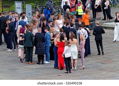 YORK, UK - JUNE 29, 2016: Teenage girls and boys gather together downton York wearing impressive dresses and formal suits on their 'leavers day'
