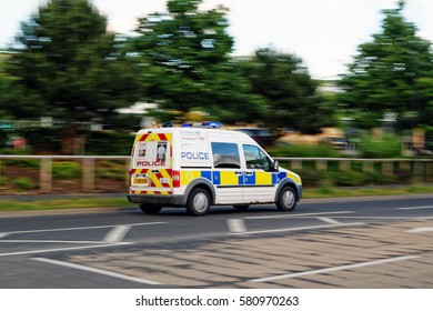 YORK, UK - JUNE 29, 2016: Police vehicle speeds along a street in York in response to an emergency call.