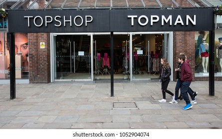 YORK, UK - MARCH 23, 2018. A group of teenagers walking past the front of the clothing store Topman and Topshop which is owned by the Arcadia Group.