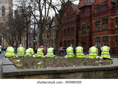 YORK, UK - MARCH 24, 2016 - Workmen wearing hi-visibility clothing taking a break from construction in the city of York, England.