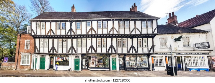 YORK, UK - NOVEMBER 2, 2018: View of a timber framed commercial building. York is a historic wall city in North Yorkshire.