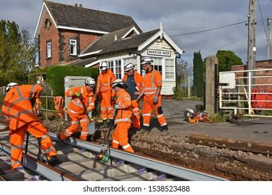 York UK Oct 20 2019 teams of permanent way engineers replacing track work near Marston Moor level crossing on the York : Harrogate : Leeds railway line, the concrete sleepers replacing wooden ones.