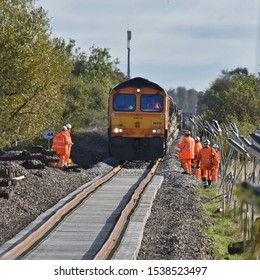 York UK Oct 20 2019 a train depositing ballast on the newly replaced track work near Marston Moor level crossing on the York : Harrogate : Leeds railway line