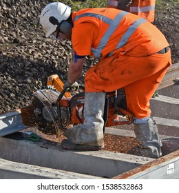 York UK Oct 20 2019 a railway engineer trims the end of a new rail with a Mechanical disc cutter whilst upgrading track work on the York : Harrogate : Leeds railway line. a railway in Northern England