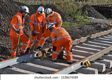 York UK Oct 20 2019 Railway Engineers joining two rail sections during the installation of new track on the Leeds : Harrogate : York Railway line in Northern England