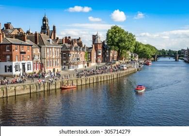 York, United Kingdom - August 7, 2015: View over the River Ouse to the pedestrian area in the city of York, UK.York is a historic walled city in North Yorkshire, England.