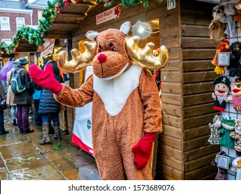 York, Yorkshire, England – November 23 2019.  Man dressed up as Rudolph the Red Nosed Reindeer at the 2019 Christmas market in York