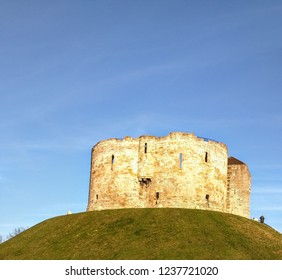 York, Yorkshire, UK, 12/28/2014 Standing on top of a hill owned by English Heritage Clifford's Tower is part of  the landscape of York