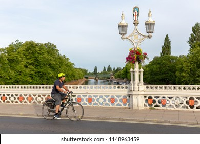 YORK,ENGLAND-JULY 4, 2018: Cyclist commuting and crossing Lendal bridge in York during the morning.