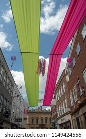 YORK,ENGLAND-JULY 7 2018: coney street York decorated with colourful fabric during the 2018 blooming York festival.