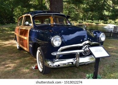 Yorklyn, DE/USA-Sept 22, 2019:  Front full length view of museum quality of rare 1949 Ford Woody wagon, in royal blue and wood.  Chrome sparkles, and is parked outdoors with no distractions.