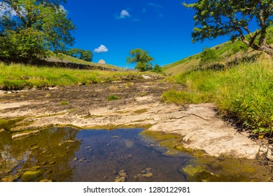 Yorkshire Dales, UK, England, 2018. River Wharfe, Kettlewell,  Yorkshire Dales during one of the hottest summers on record with no rainfall.  Rivers dried up and the earth was scorched.  Landscape.