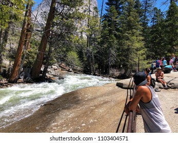 YOSEMITE, CA, USA - MAY 2, 2018: Tourist on top of vernal waterfalls in a national park
