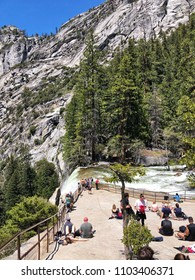 YOSEMITE, CA, USA - MAY 2, 2018: Tourist on top of vernal falls in a national park