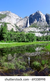 Yosemite Falls reflected in a pond in Yosemite National Park