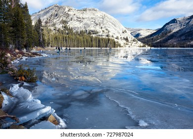 Yosemite frozen lake winter landscape. People walk on the ice.