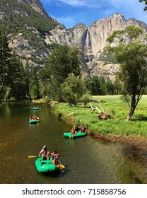 Yosemite National Park, CA, USA August 14, 2017 Families raft down the Merced River in Yosemite National Park, California.  After years of drought, the water levels were sufficient in 2017 for rafting