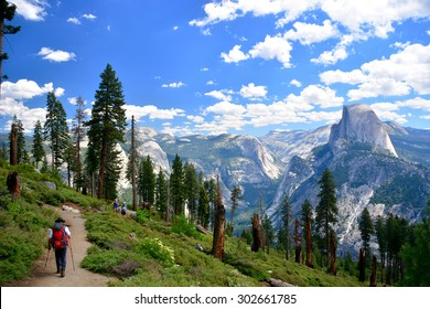 Yosemite National Park/ climbing half dome on a sunny day/ Yosemite, USA - July 6, 2015: Yosemite National Park, Hikers hiking around and climbing half dome on a sunny day