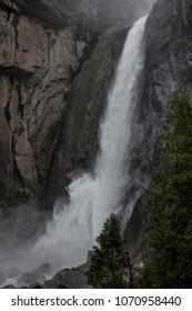 Yosemite National Park's gushing Yosemite falls shooting out sprays of twirling water