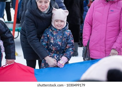 Yoshkar-Ola, Russia - February 19, 2018 Smiling people during participation in the Shrovetide game
