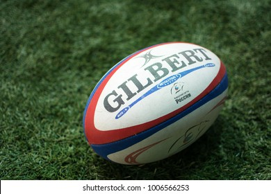 Yoshkar-Ola, Russia - January 20, 2018 Official ball European Championship Rugby Gilbert on sports field with green grass for the game of rugby. Focus on ball, sports base at background.