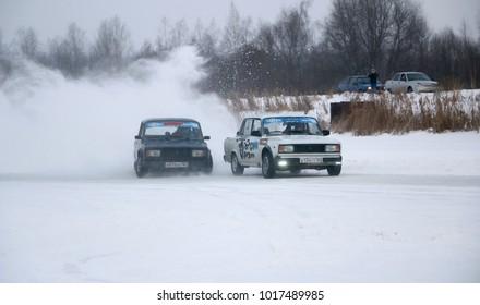 YOSHKAR-OLA, RUSSIA - JANUARY 21, 2018: Winter auto show - Drift on cars on an ice track, on a frozen lake. parallel drift