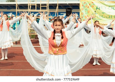 Yoshkar-Ola, Russia - Jule 23, 2016 A young girl dances in a national Tatar costume at the DRUZHBA stadium during her performance at the national Tatar festival