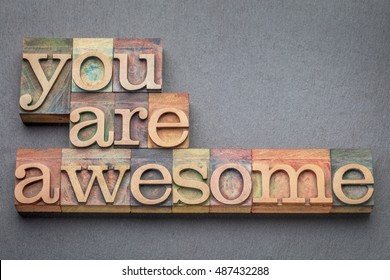 you are awesome word abstract in letterpress wood type blocks against gray slate stone