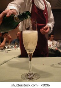 Are you being served? Waiter serving a glass of chilled champaign