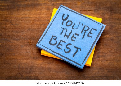 You are the best  - handwriting on a sticky note against rustic wood