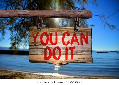 You can do it motivational phrase sign on old wood with blurred background