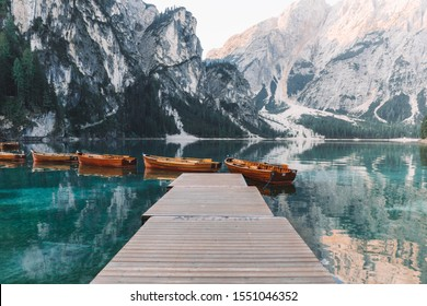 You can see the beautiful Lago di braie in the Dolomites and the famous small boats. Look out the reflection in the water.