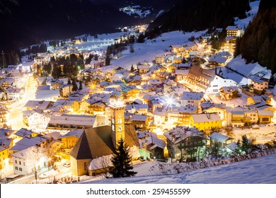 You can see Campitello-di-Fassa resort in Val di Fassa valley. This is Trentino region of Italy with Dolomites mountains.