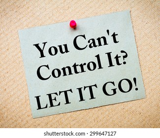You Can't Control It? Let It Go! Message written on recycled paper note pinned on cork board. Motivational concept Image