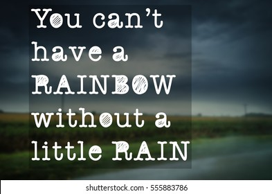 """You can't have a rainbow without a little rain"" text on blurry country road background. Cloudy and rainy day. Motivation concept."