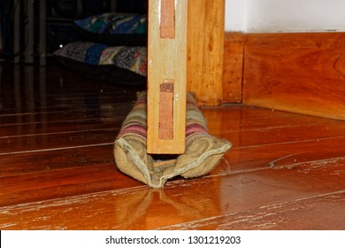 You don't have to move your draught excluder with a double one, which slides under the door and moves with it.