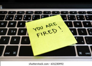 You are fired. Dismissal, downsizing, layoff message in office.