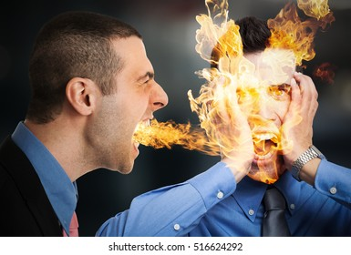 You are fired! Fire coming out from a businessman mouth setting to fire an employee
