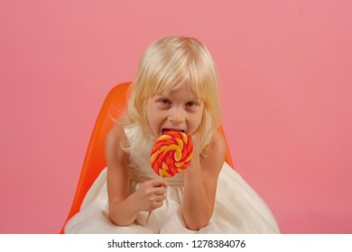 You get tons of flavor out of the stick. Little girl hold lollipop on stick. Happy childhood food. Little child with sweet lollipop. Happy candy girl.