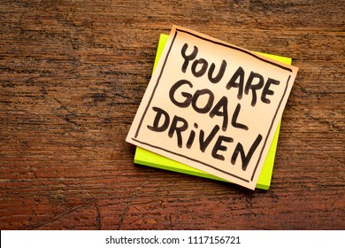 You are goal driven - positive affirmation - handwriting on a sticky note agianst rustic wood
