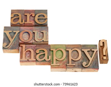 Are you happy question in vintage grunge wood letterpress printing blocks, isolated on white