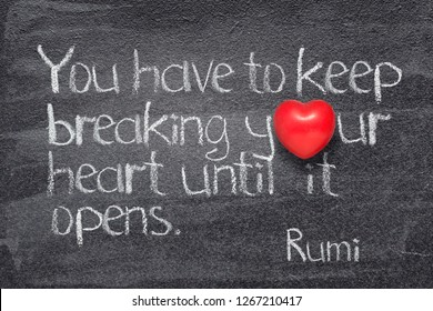 You have to keep breaking your heart until it opens -  ancient Persian poet and philosopher Rumi quote written on chalkboard with red heart symbol instead of O