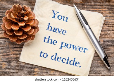 you have the power to decide - inspirational handwriting on a napkin against rustic wood
